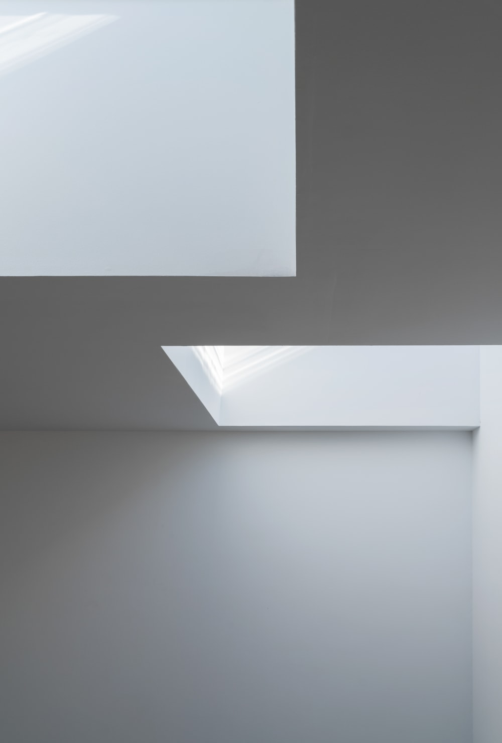 This angle of the two skylights appears as if a piece of modern art. This lovely design maximizes the amount of natural lighting the two skylights afford.