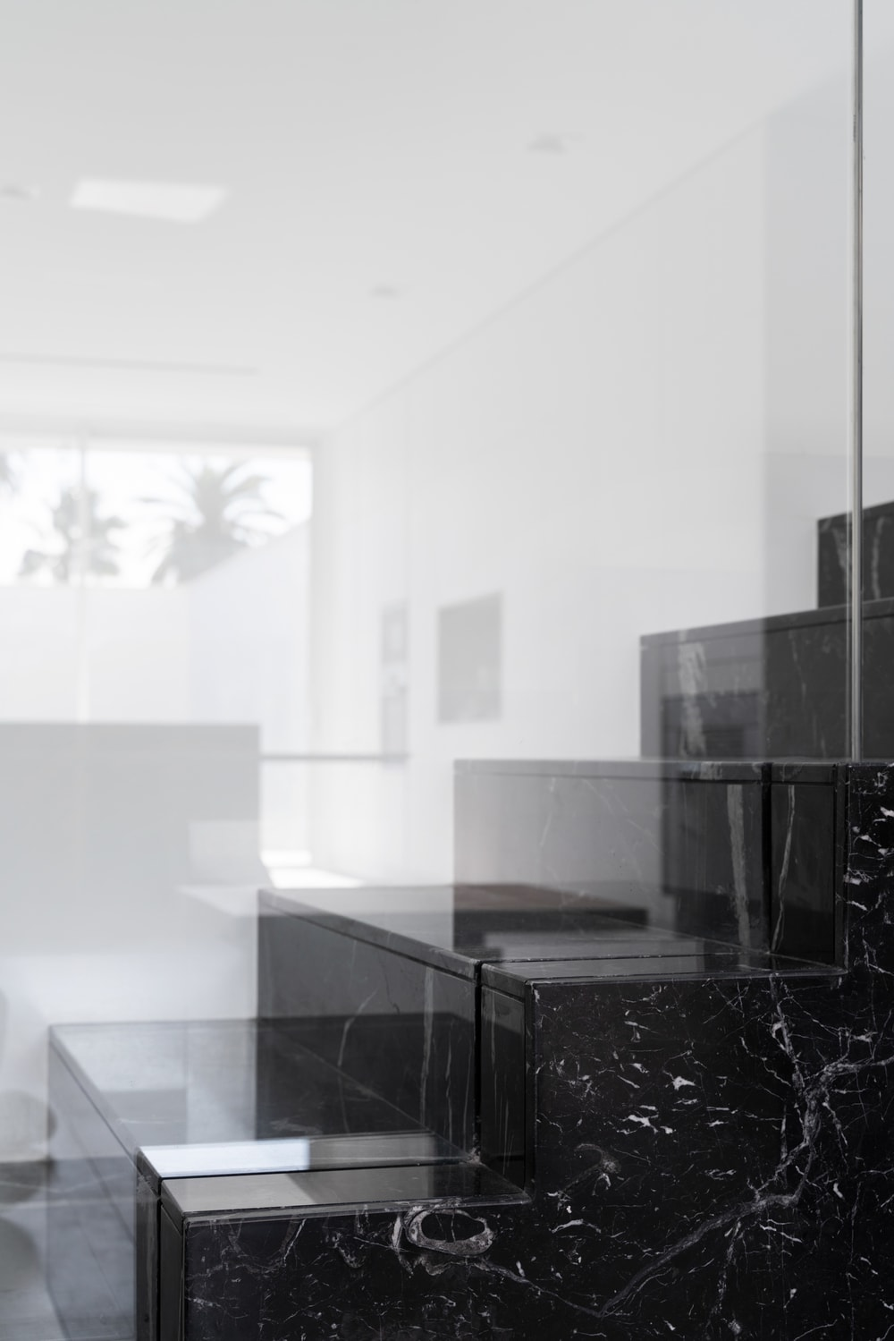 The side of the staircase is also made of black marble giving it a solid single structure look.