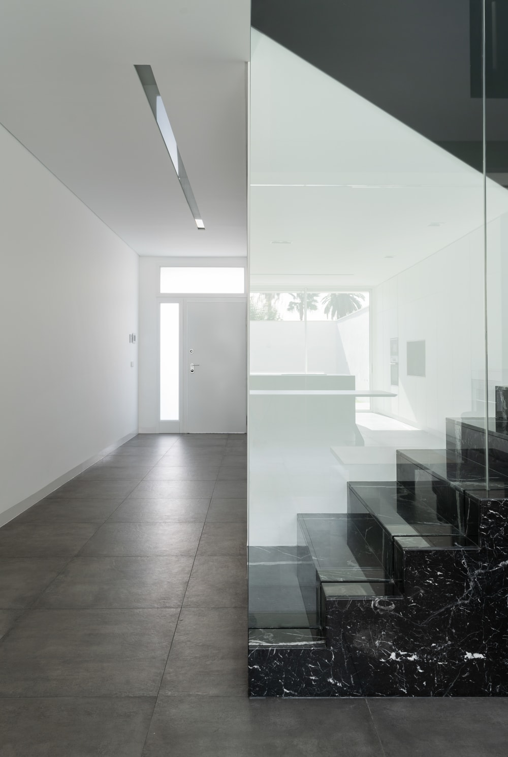 Upon entry of the house, you are welcomed by this simple foyer with white walls and ceiling complemented by gray flooring tiles.