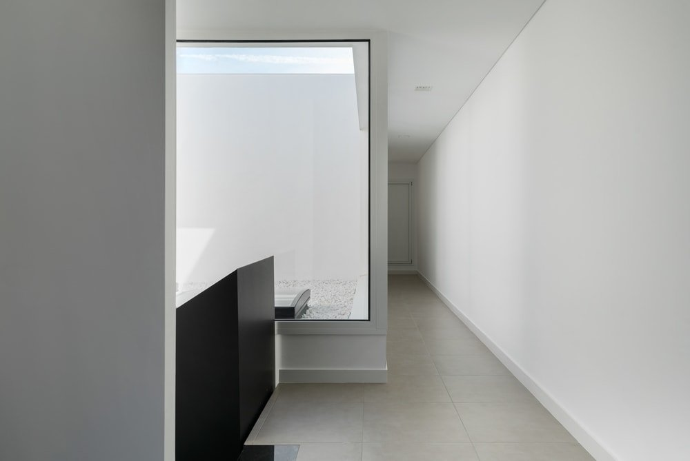 This is the second floor landing with a low black wall for the indoor balcony.