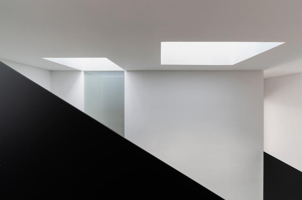 This angle shows the two bright skylights that bring in natural lighting for the staircase area.
