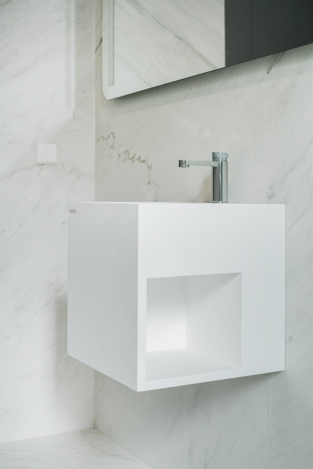 This is the other side of the white floating vanity beside the toilet. This has a built-in alcove on the side for use of those on the toilet.