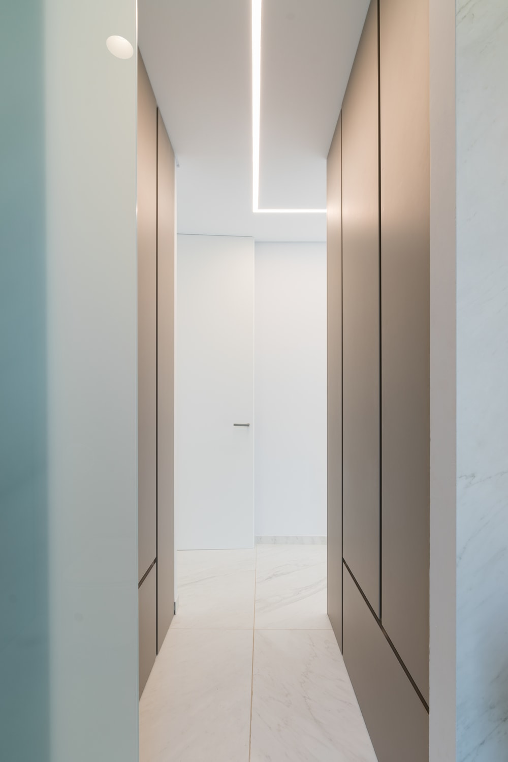 This is a part of the large closet with a couple of modern structures built into the walls of this narrow area.