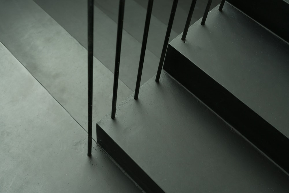 These rods are placed on the side to provide safety and to augment the beauty of the black staircase.