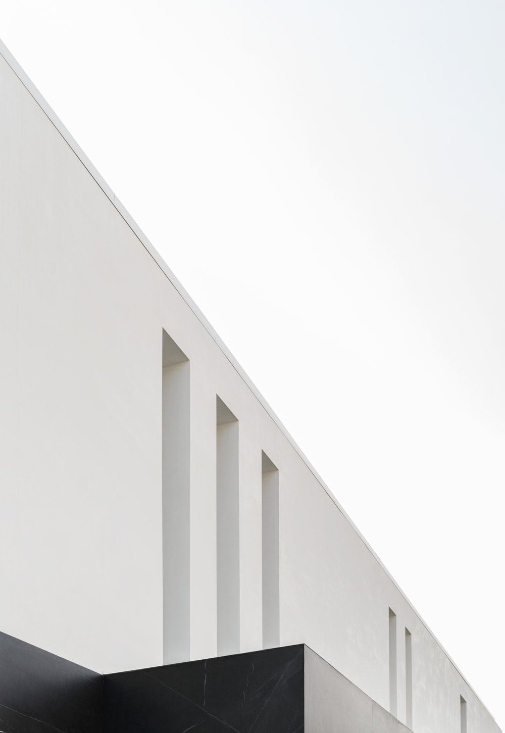 This is a close inspection of the tall and thin glass windows above the main entrance of the house that gives a unique look to the house.