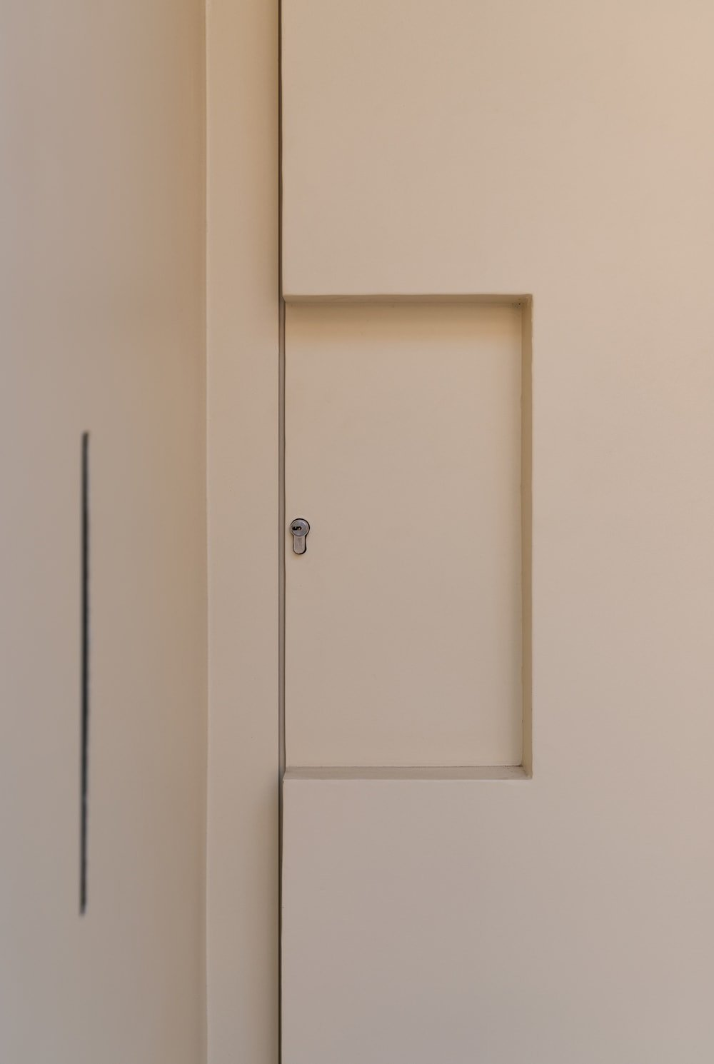This is a close look at the main door with a key access and a modern design to it.