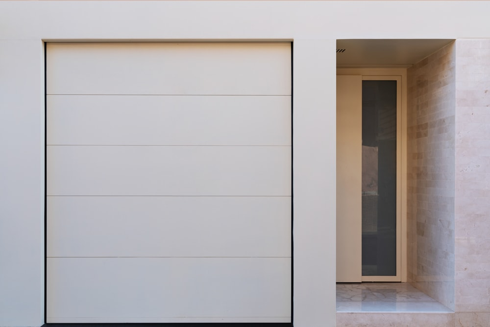 This view shows the proximity of the garage door to the main entrance of the house interior.