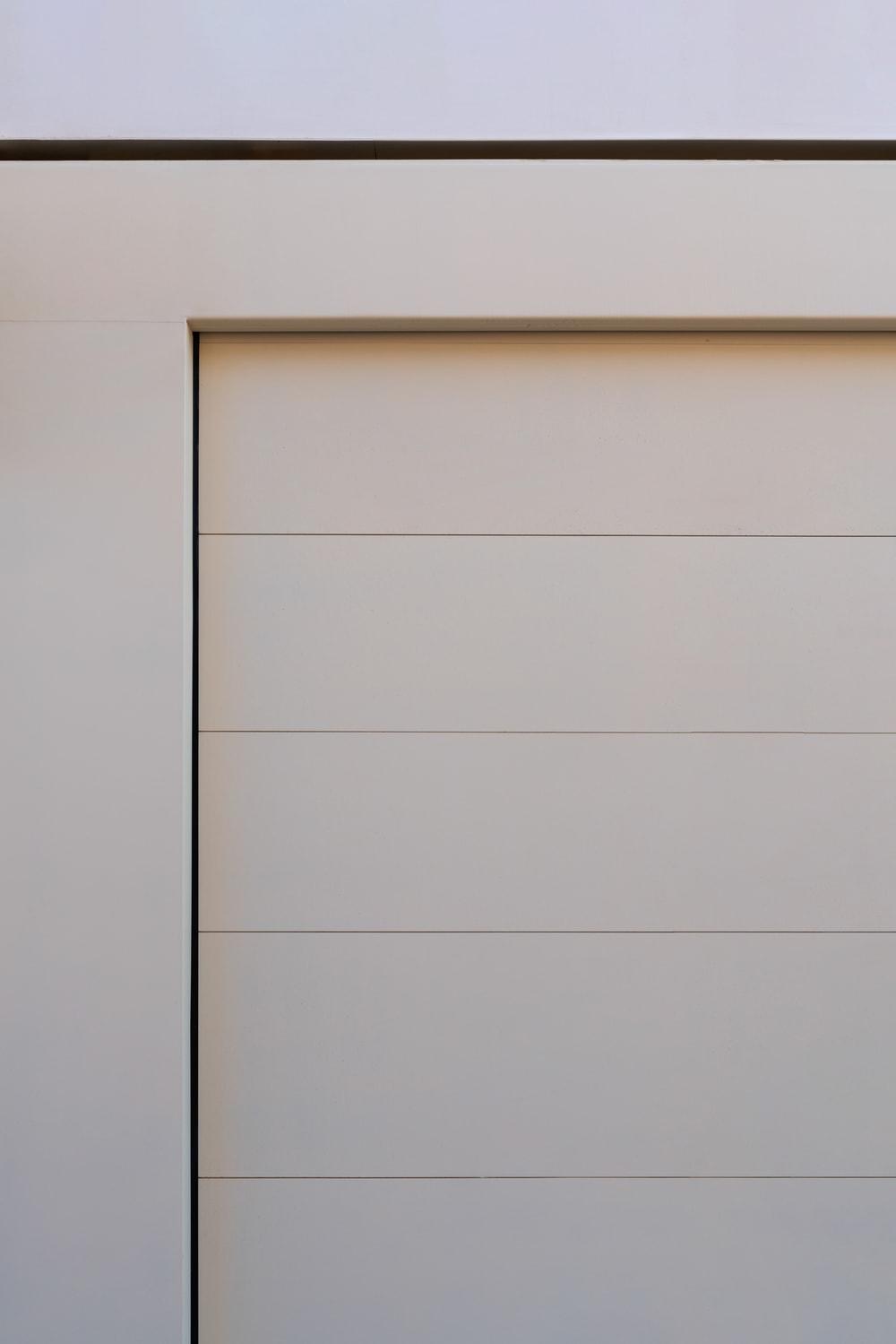 This garage door has a modern design to its pull-up doors.