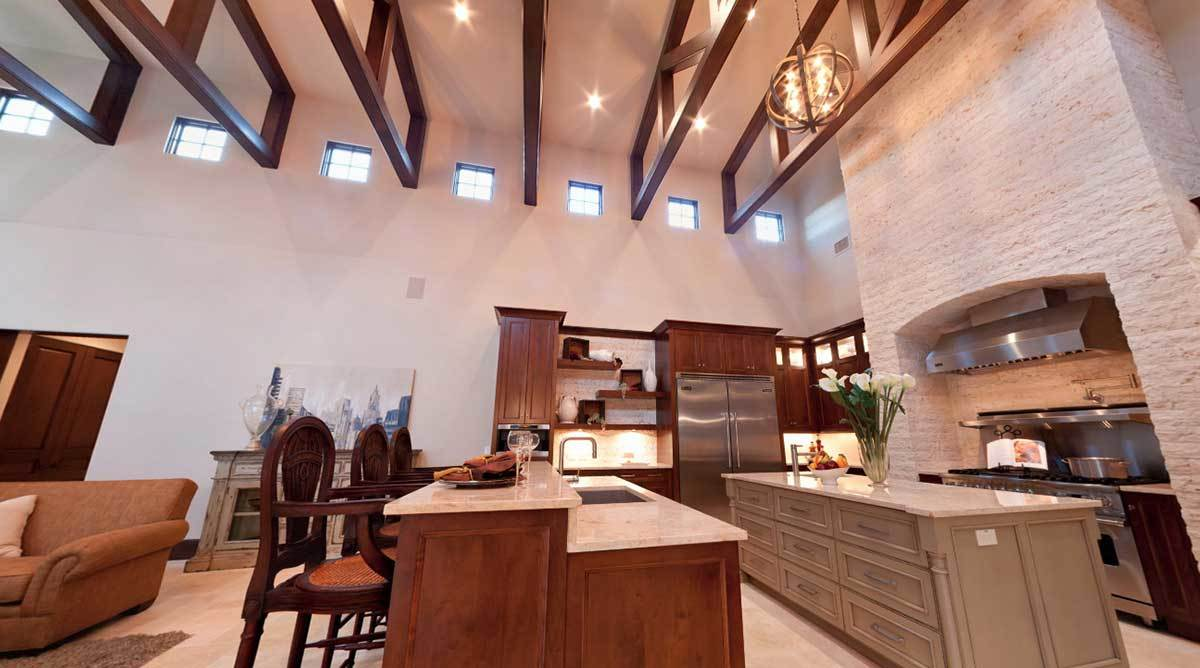 Interior great room of Tuscan style house with extensive woodwork