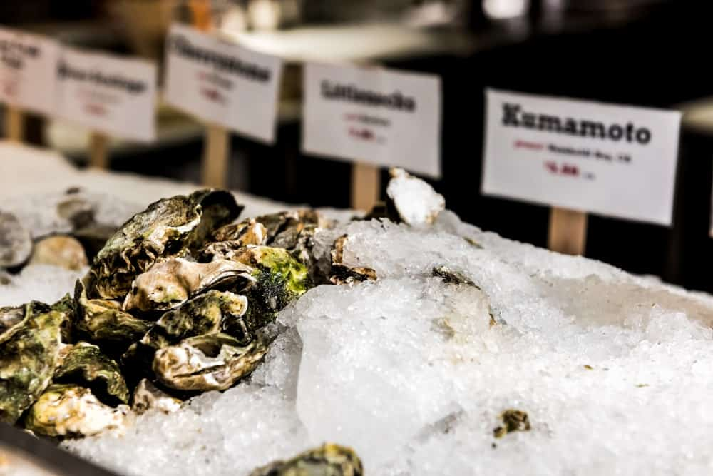 A bunch of kumamoto oysters for sale.