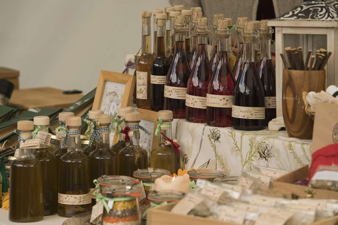 Shelves full of corked honey wines set up in the style of the Middle Age.