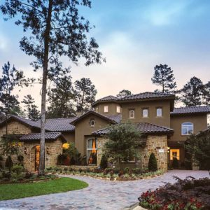 Tuscan style house exterior with stucco and stone with tile roof
