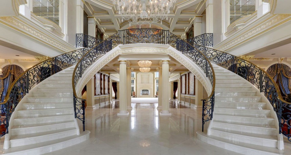 Here's the mansion's grand entry foyer boasting an elegant double staircase. Images courtesy of Toptenrealestatedeals.com.