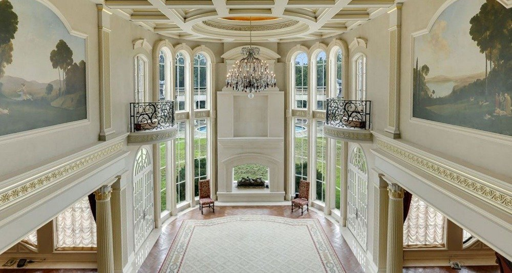 Here's the living hall with a high ceiling and a stunning ceiling lighted by a gorgeous chandelier. Images courtesy of Toptenrealestatedeals.com.