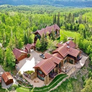 Aerial view of the man house showcasing its exterior and the gorgeous natural landscape surrounding it. Images courtesy of Toptenrealestatedeals.com.