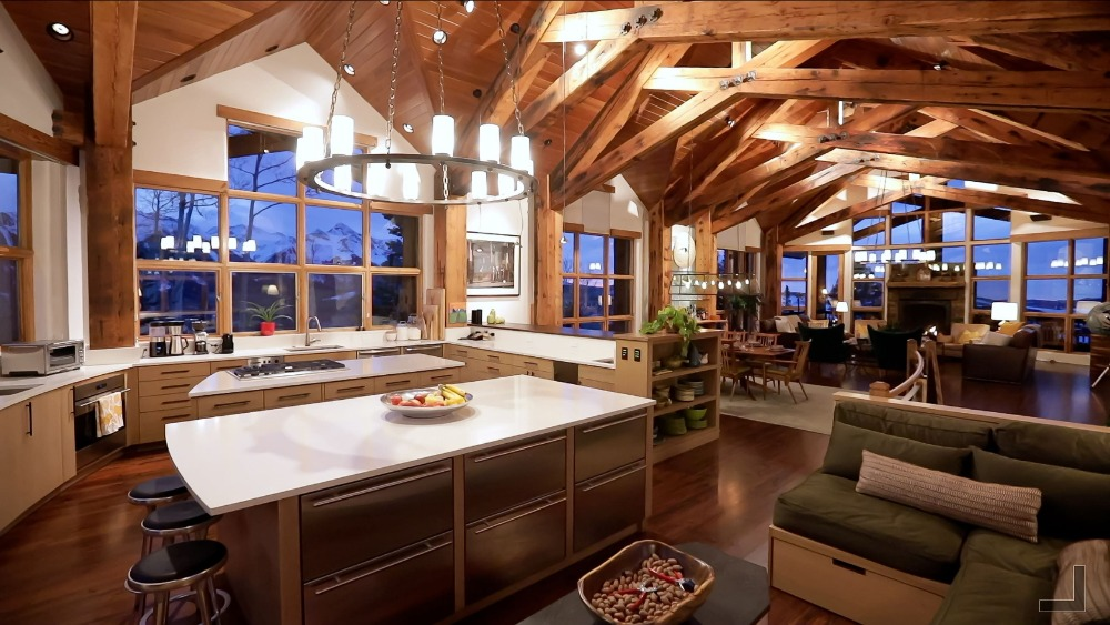 Large kitchen area boasting two islands and a cozy loft on the side. Images courtesy of Toptenrealestatedeals.com.