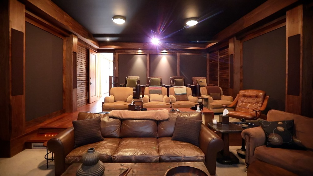 Another look at the home's home theater showcasing the set of sectional seats. Images courtesy of Toptenrealestatedeals.com.