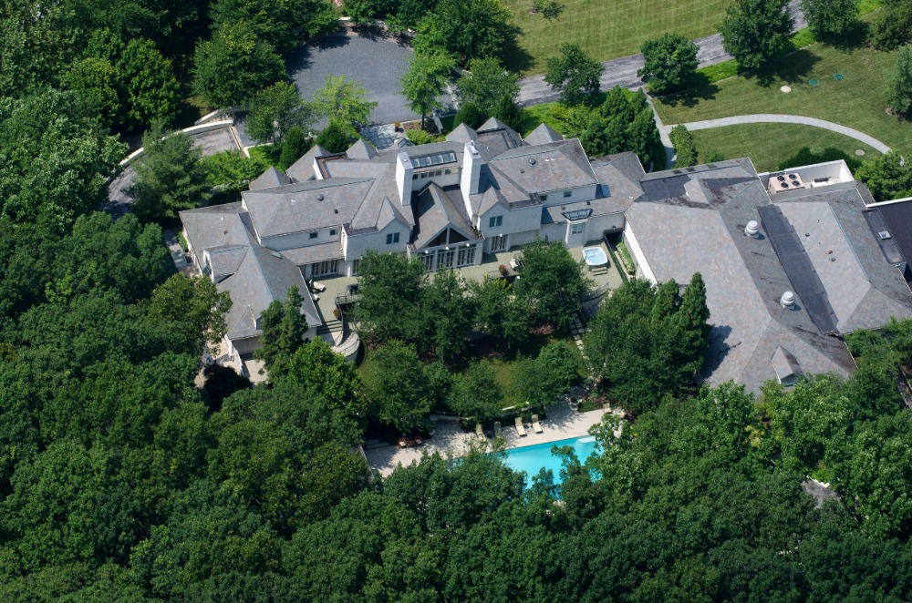 Bird's eye view of the property showcasing the house's exterior surrounded by the lush greenery. Images courtesy of Toptenrealestatedeals.com.