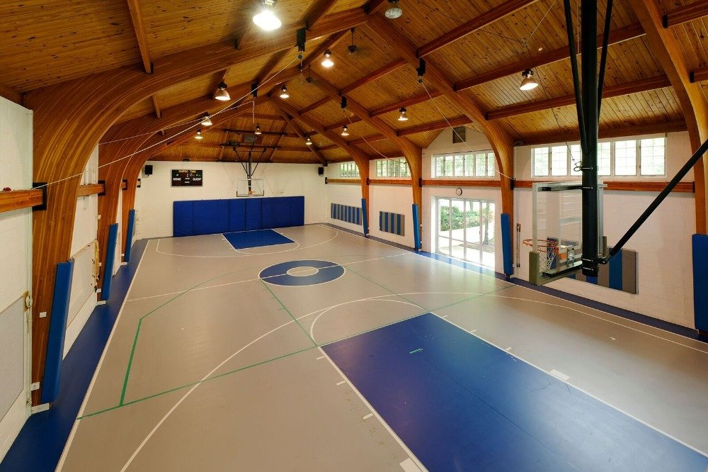The home also includes an indoor basketball court for additional entertainment. Images courtesy of Toptenrealestatedeals.com.