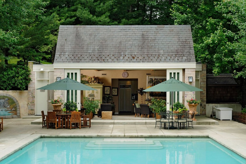 Outside, there's a swimming pool and outdoor dining table sets, along with an outdoor living. Images courtesy of Toptenrealestatedeals.com.