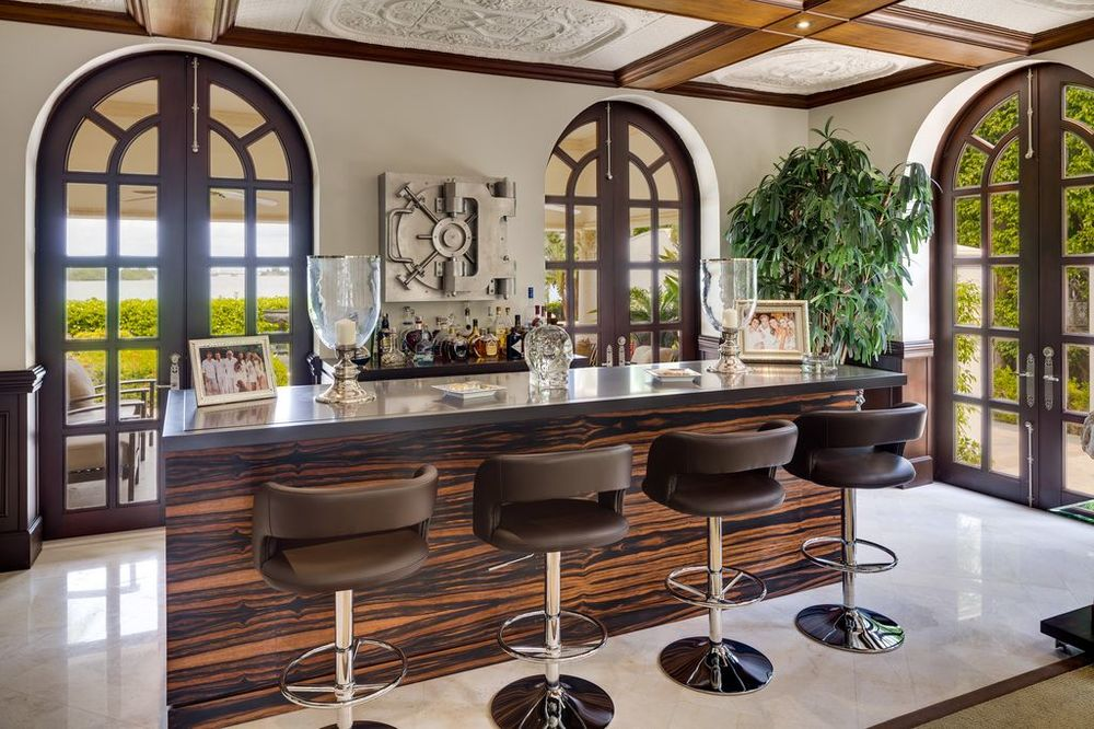 This is the lovely bar with sophisticated dark wood counter paired with cushioned dark brown leather stools. Images courtesy of Toptenrealestatedeals.com.