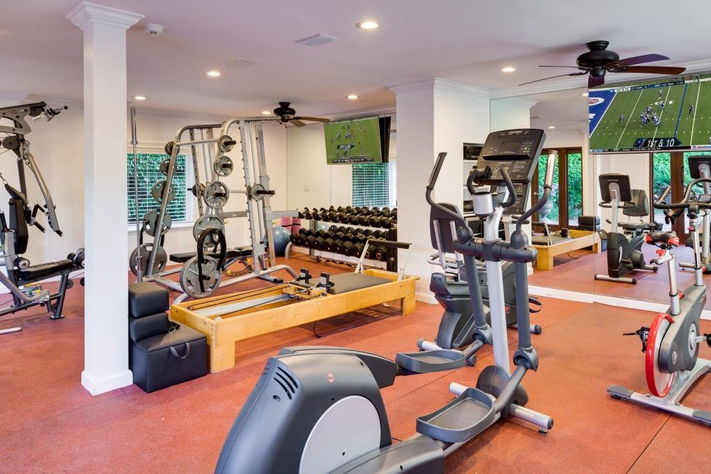 This is the fully equipped gym that has a bright white ceiling and pillars to contrast the terracotta tone of the flooring. Images courtesy of Toptenrealestatedeals.com.