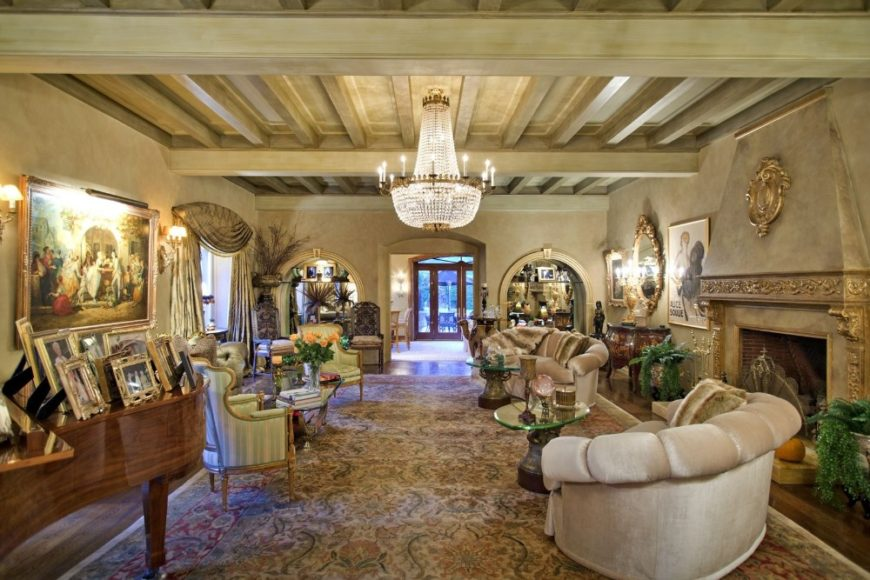 Another look at this formal living room with a set of cozy seats and a piano on the side, along with an elegant fireplace. Images courtesy of Toptenrealestatedeals.com.