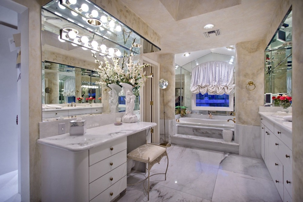 This bathroom features a powder desk, a sink counter, a drop-in soaking tub and a walk-in shower room. Images courtesy of Toptenrealestatedeals.com.
