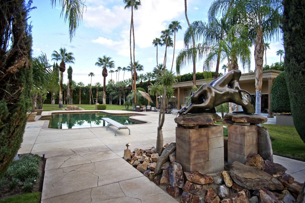 There's an attractive landscaping decor near the swimming pool area as well. Images courtesy of Toptenrealestatedeals.com.
