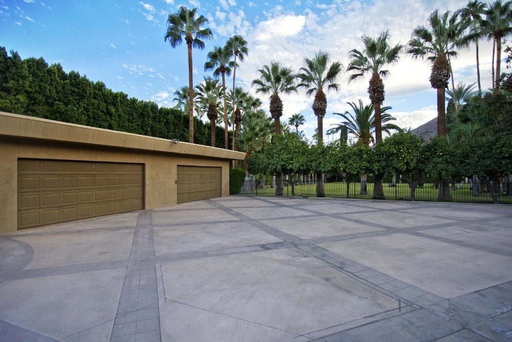 Here's a look at the home's wide driveway and two-port car garage. Images courtesy of Toptenrealestatedeals.com.