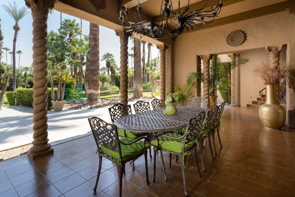 A look at the home's outdoor dining set on the side of the backyard. Images courtesy of Toptenrealestatedeals.com.