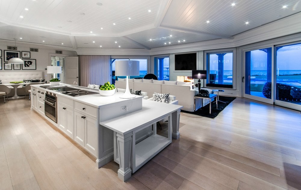 This kitchen island is just beside the living room. It also functions as a breakfast bar with lower tier countertop paired with cushioned chairs. Images courtesy of Toptenrealestatedeals.com.