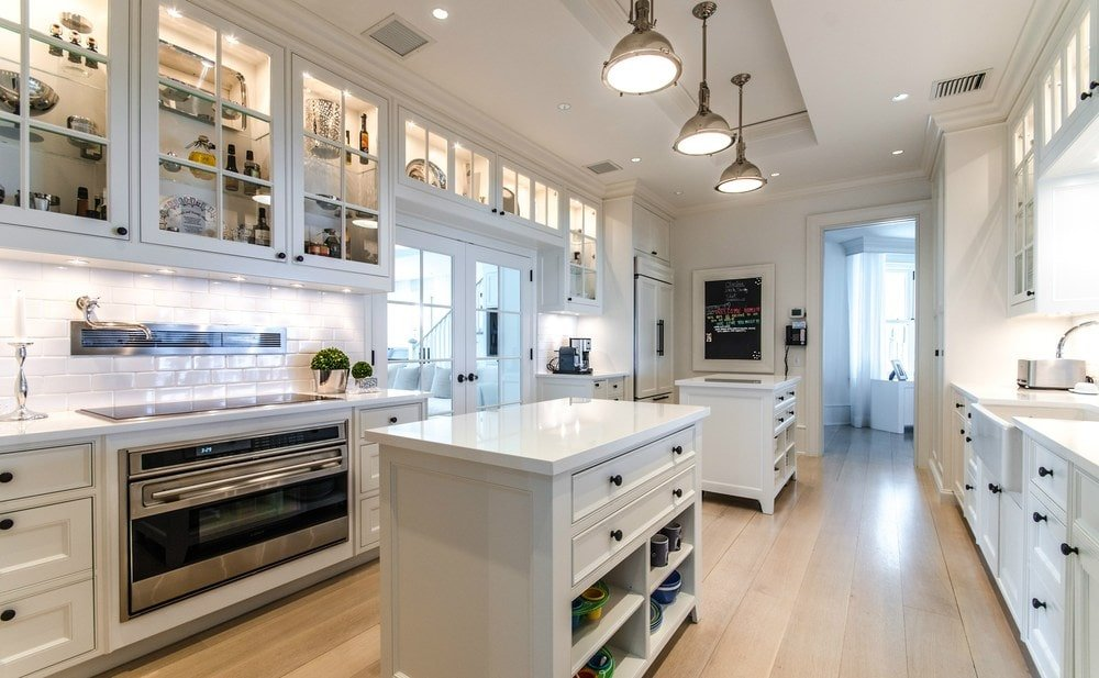 This kitchen has a couple of small kitchen islands with the same white cabinetry as those lining the walls. These houses the stainless steel appliances. Images courtesy of Toptenrealestatedeals.com.