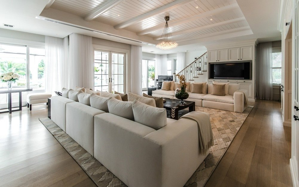 This other living room has a couple of beige sofas flanking a coffee table in the middle of the large beige patterned area rug. Images courtesy of Toptenrealestatedeals.com.