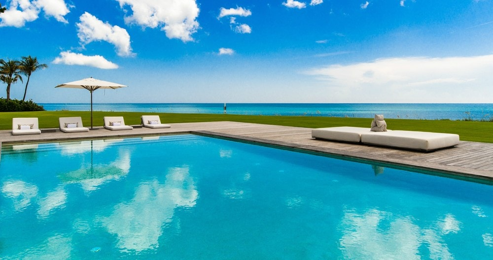 This is the view of the ocean from the vantage point of the pool. You can also see here that the there are various sitting area at the edge of the pool. Images courtesy of Toptenrealestatedeals.com.