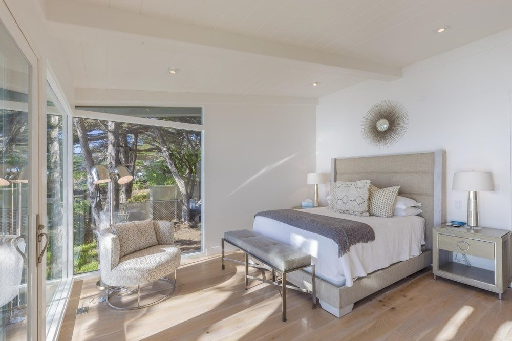 This is a simple bedroom with a beige bed that has white sheets to match the beige walls and ceiling complemented by the hardwood flooring. Images courtesy of Toptenrealestatedeals.com.