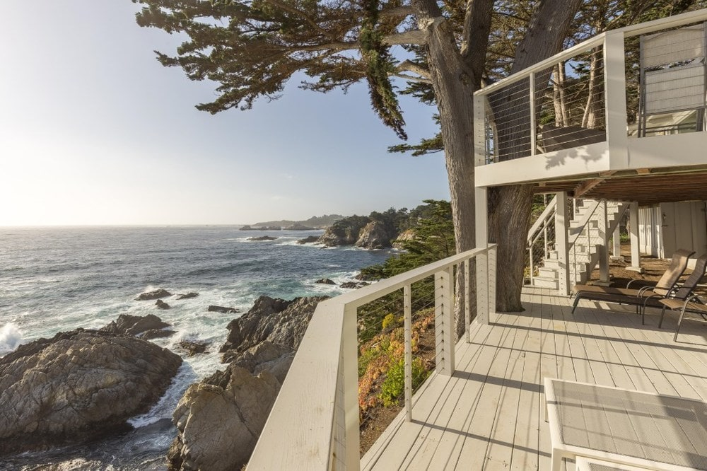 This view of the viewing deck shows its two tiers that maximizes the beautiful scenic view of the rocky ocean cliff view. Images courtesy of Toptenrealestatedeals.com.
