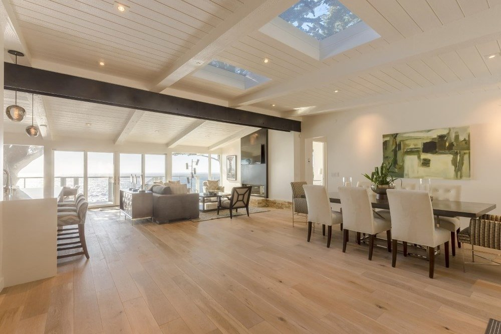 This angle shows more of the skylights above the dining area. This also shows the wide hardwood flooring that complements the beige walls. Images courtesy of Toptenrealestatedeals.com.