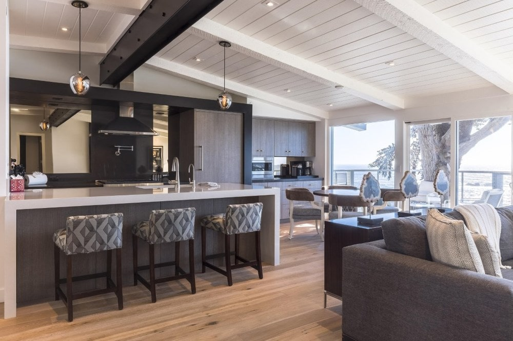 This angle shows that the kitchen is housed in the same large open room as the living room and dining areas. Images courtesy of Toptenrealestatedeals.com.