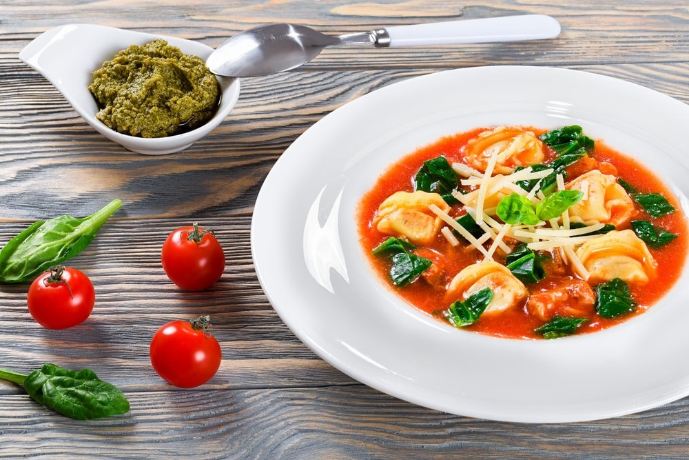 A delicious bowl of creamy spinach and Italian sausage soup.