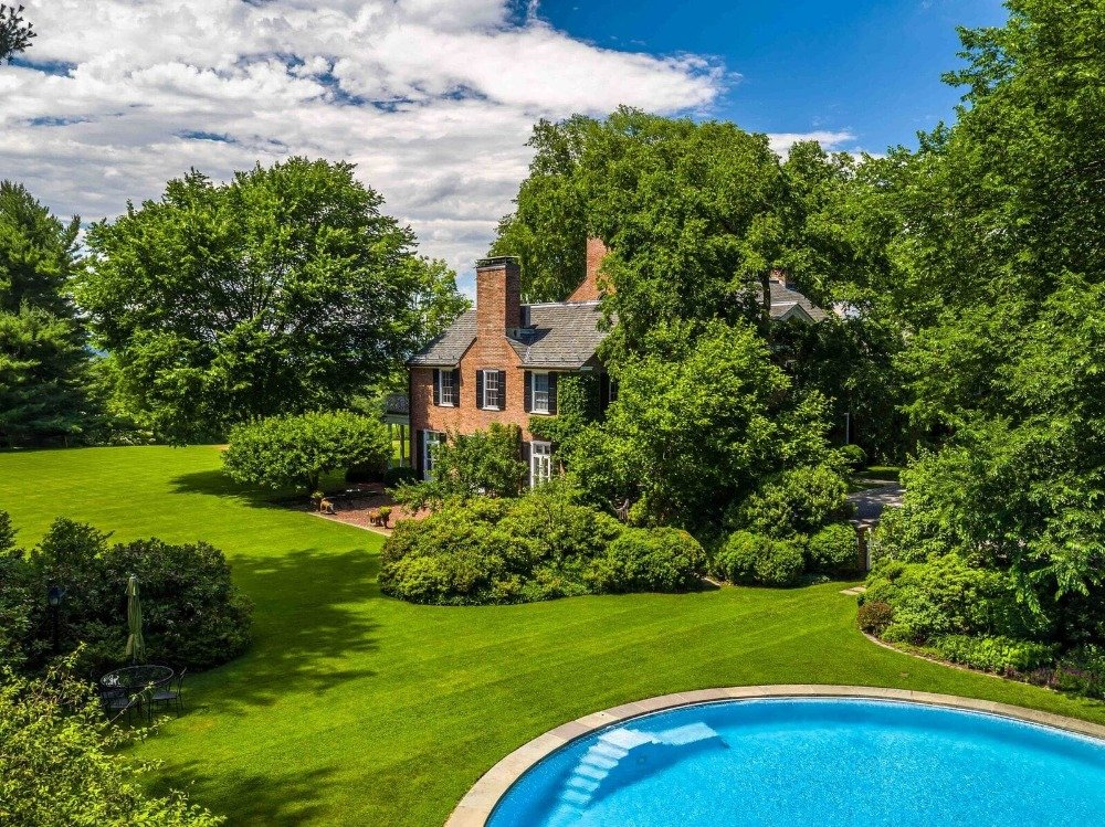 This aerial view showcases the home's exterior, its lush greenery and its swimming pool. Images courtesy of Toptenrealestatedeals.com.