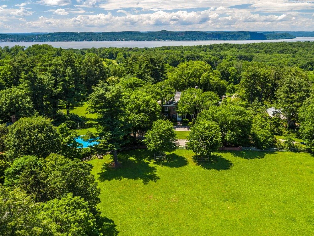 Aerial view of the property boasting its lush greenery and well-maintained lawns. Images courtesy of Toptenrealestatedeals.com.
