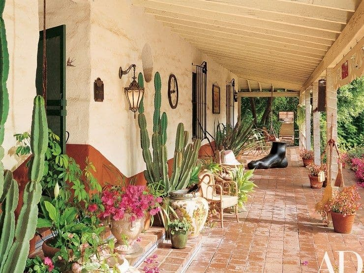 This is the patio of the house filled with decorative potted plants and sculptures that bring charm to the area. This has terracotta flooring tiles that transitions to the garden beside it.