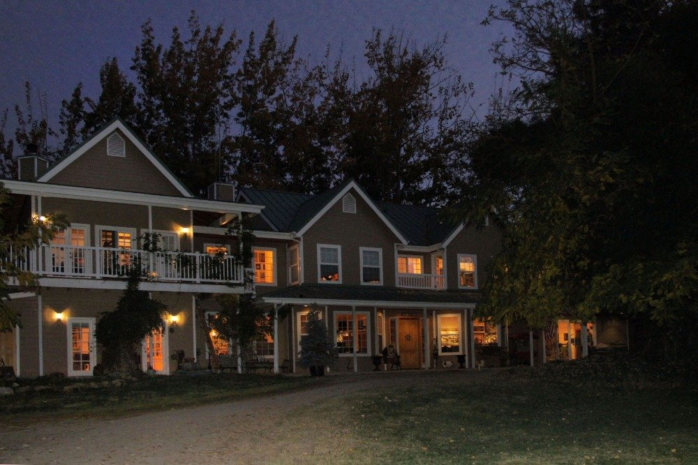 Another view of the ranch's main house's walkway and exterior with interior lighting on. Images courtesy of Toptenrealestatedeals.com.
