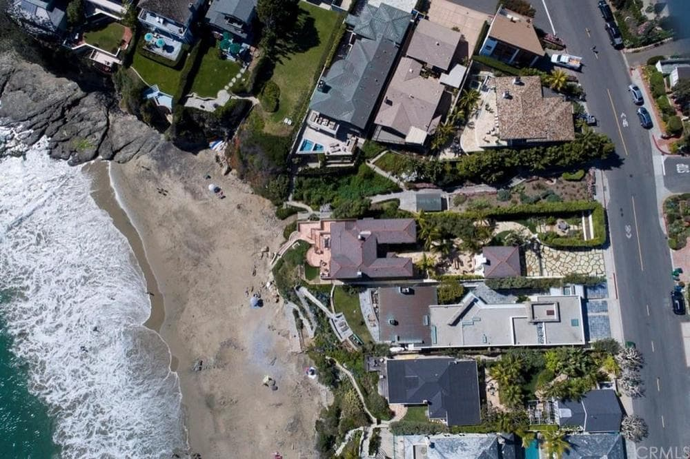 This is the top aerial view of the house showing its proximity from the main road, the ocean and the surrounding structures. Images courtesy of Toptenrealestatedeals.com.