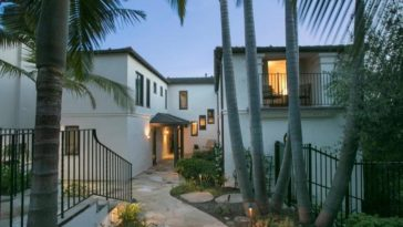 This is the gorgeous front of the house with white exteriors complemented by the stone walkway, tall tropical trees and shrubs on the side along with wrought-iron fences. Images courtesy of Toptenrealestatedeals.com.