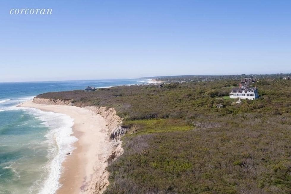 Aerial view of the area showcasing the beach front and the house's exterior, along with the beautiful landscaping surrounding the house. Images courtesy of Toptenrealestatedeals.com.