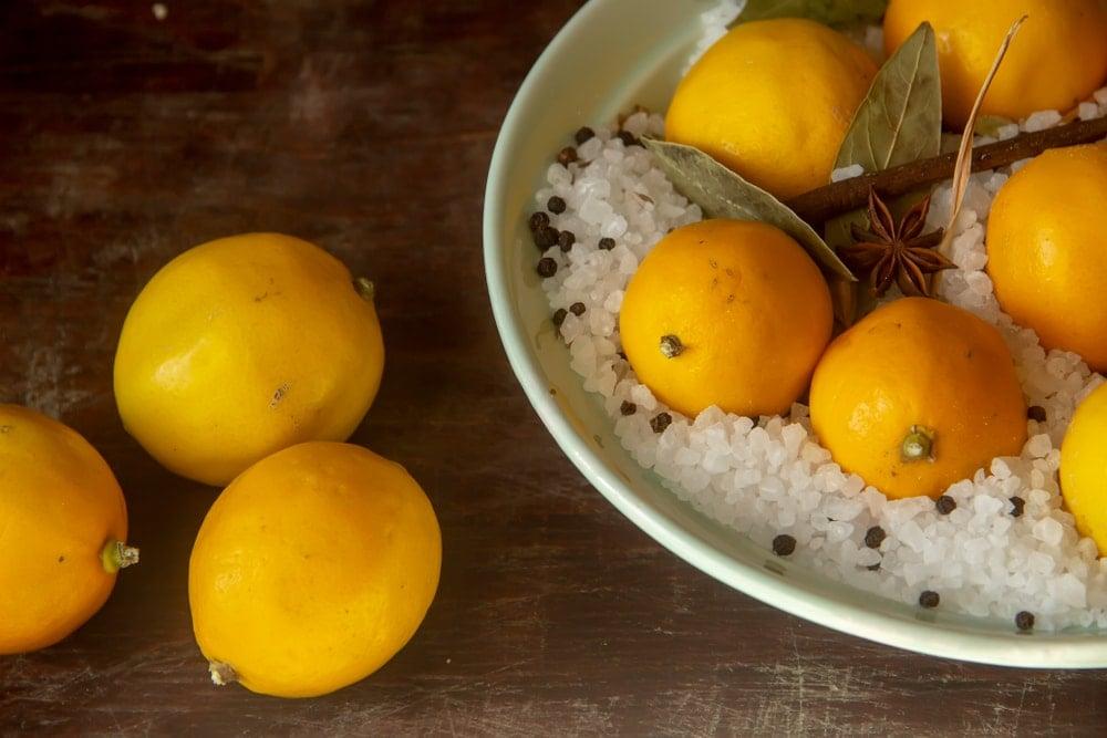 A bowl of lemon, salt and spices.