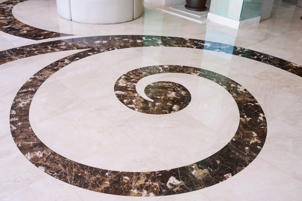 A close look at a tiled flooring with granite accents.