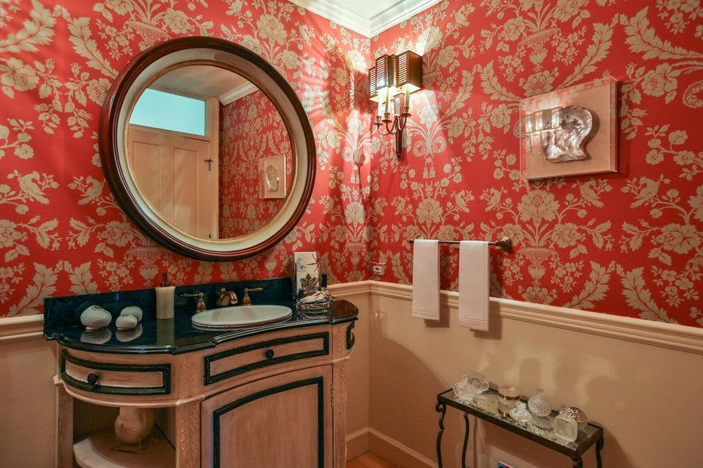 This is the gorgeous powder room dominated by the vibrant red patterned wallpaper that contrasts the light wooden wainstcoting that matches well with the wooden vanity. Images courtesy of Toptenrealestatedeals.com.